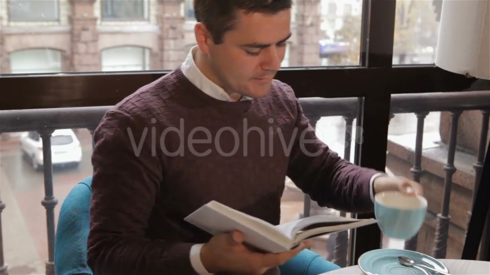 Man Reads Book At The Cafe - Download Videohive 18380237